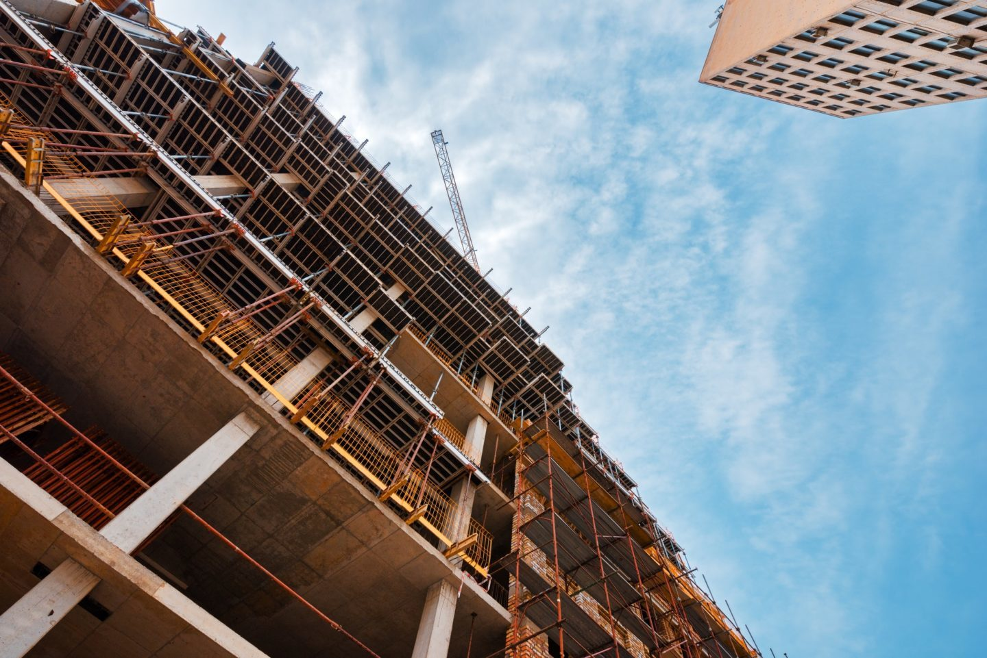 building construction site with scaffolding e1600423620304