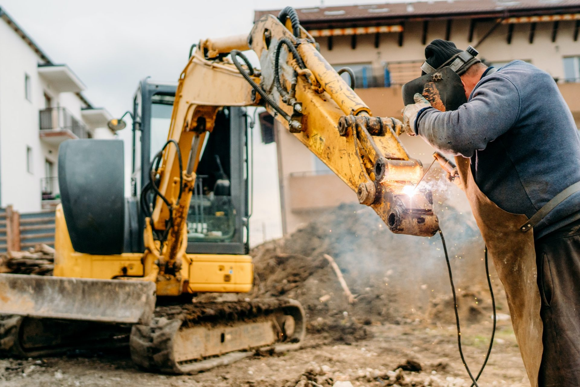 construction and building site broken excavator and professional welder e1600416999476